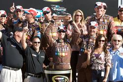 Victory lane: race winner Kyle Busch accepts the winner's trophy