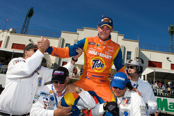 Race winner Andrew Ranger celebrates with course marshalls
