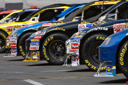 Race cars sit on pit road