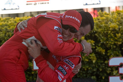 Helio Castroneves and Ryan Briscoe celebrate