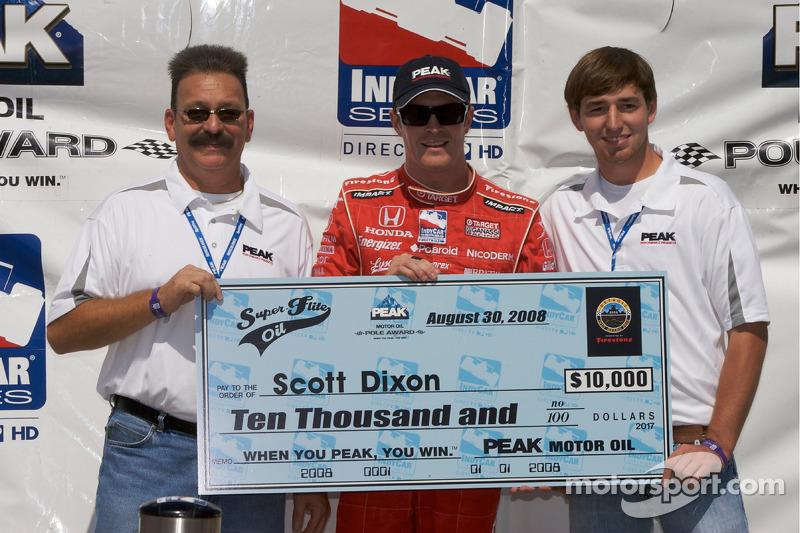 Pole winner Scott Dixon with the pole award check