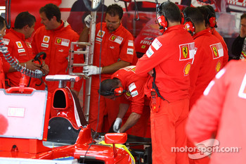 Ferrari mechanics looking at the rear of the car after Kimi Raikkonen, Scuderia Ferrari crashed and broke the rear wing