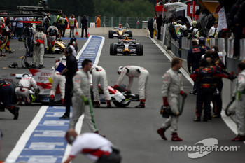 Mark Webber, Red Bull Racing, RB4 drives down a crowded pitlane