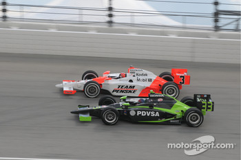 Helio Castroneves and Ernesto Viso run together