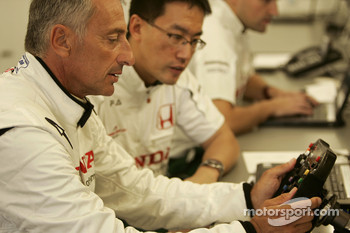 Riccardo Patrese checks the steering wheel of the Honda RA107
