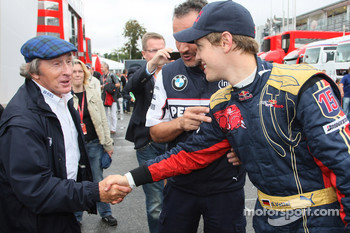 Pole winner Sebastian Vettel celebrates with Sir Jackie Stewart