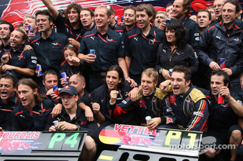 Pole winner Sebastian Vettel celebrates with Sébastien Bourdais and his team
