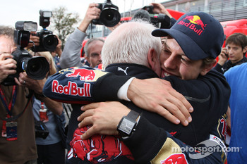 Race winner Sebastian Vettel celebrates with his father Norbert Vettel