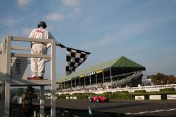 Tony Brooks and Ferrari Dino takes the checkered flag
