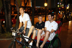 Sebastian Vettel and Mark Webber on their way to the Raffles Hotel