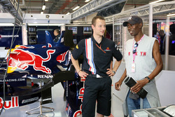 A Red Bull Racing crew member and Maxi Jazz in the garage
