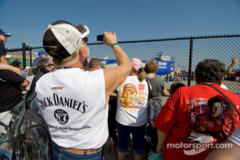 Fans try to catch a glimpse of their favorite drivers