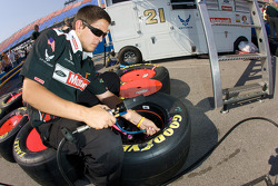 Motorcraft Ford crew member prepares wheels