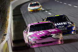 Kyle Busch leads Jimmie Johnson