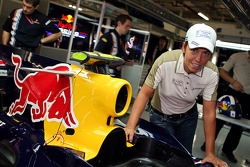Golfer Eva Steinberger in the Red Bull Racing garage