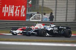 Timo Glock, Toyota F1 Team, TF108 and Nico Rosberg, WilliamsF1 Team, FW30