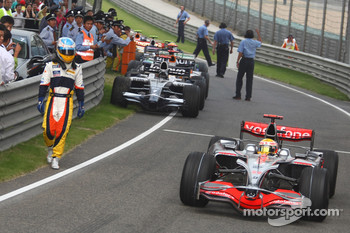 Race winner Lewis Hamilton passes Fernando Alonso
