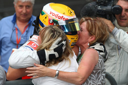 Race winner Lewis Hamilton celebates with his mother