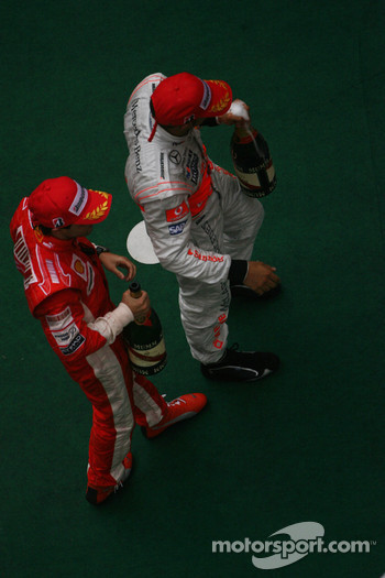 Podium: race winner Lewis Hamilton, second place Felipe Massa