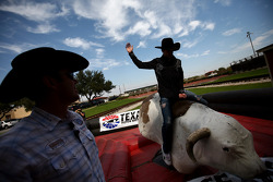 Former four-time bull riding champion Tuff Hedeman looks on as his