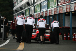 Team Penske crew pushing their car back to the pits