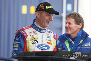 Jarmo Lehtinen and Malcolm Wilson share a light-hearted moment