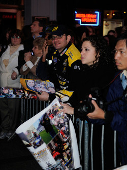 Fans wait for the top 12 NASCAR Sprint Cup Series drivers to depart the Hard Rock Cafe in Times Square