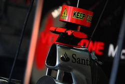 McLaren Mercedes work on the car with KERS in the garage