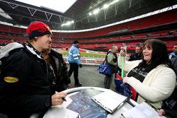 Sebastian Vettel poses for photos with a fan
