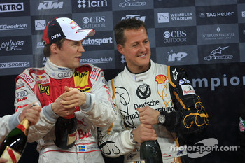 Podium: Michael Schumacher and Mattias Ekström spray champagne