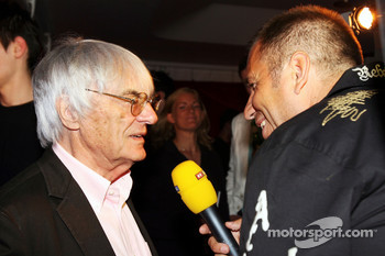 Bernie Ecclestone F1 Supremo with Kai Ebel RTL Presenter at the Fly Kingfisher Boat Party