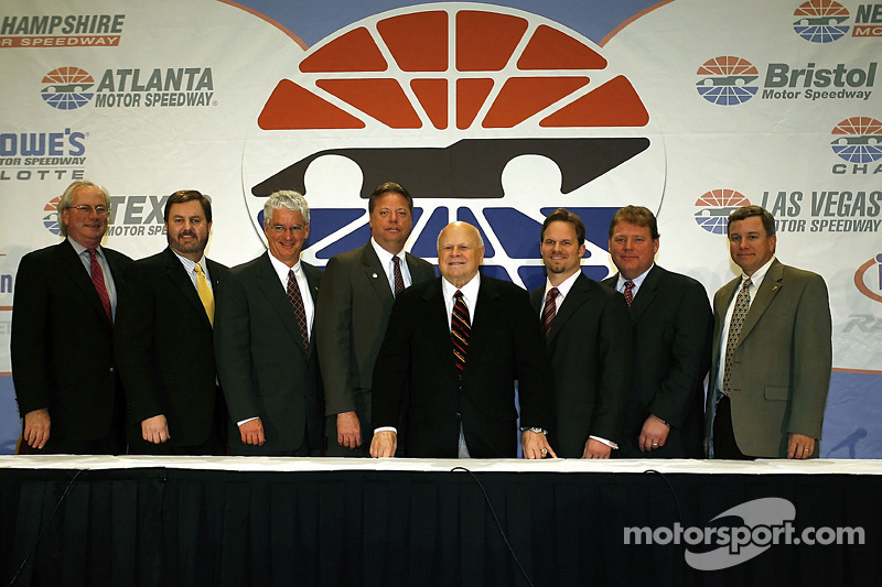 SMI Chairman and CEO Bruton Smith poses with General Managers Jeff Byrd, Eddie Gossage, Steve Page, Ed Clark, Marcus Smith, Jerry Gappens, and Chris Powell, from each track owned by SMI