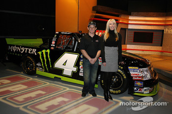 NASCAR Camping World Truck Series owner DeLana Harvick, poses with driver Ricky Carmichael, after announcing Carmichael will drive the No. 4 Monster Energy Chevrolet