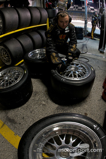 Penske Racing team member prepares tires