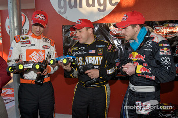 Raybestos Rookie of the Year radio-controlled car race event: Ryan Newman, Stewart-Haas Racing Chevrolet, Scott Speed, Red Bull Racing Team Toyota, and Joey Logano, Joe Gibbs Racing Toyota after the race