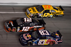 Brian Vickers, David Stremme and Matt Kenseth battle three-wide