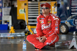 Richard Petty Motorsports Dodge crew member sits in the empty garage area