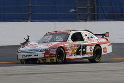 Travis Kvapil, Yates Racing Ford, blows a right front tire