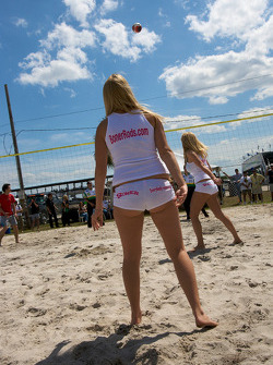 Beach volley ball game: a charming Boner Custom Rods girl
