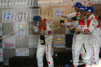P1 podium: Tom Kristensen gets a major champagne shower