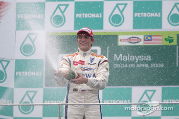 Vitaly Petrov celebrates his victory on the podium