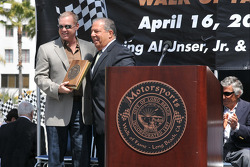 Al Unser Jr. recieves his plaque for Mayor Bob Foster