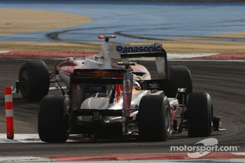 Jarno Trulli, Toyota Racing and Sebastian Vettel, Red Bull Racing