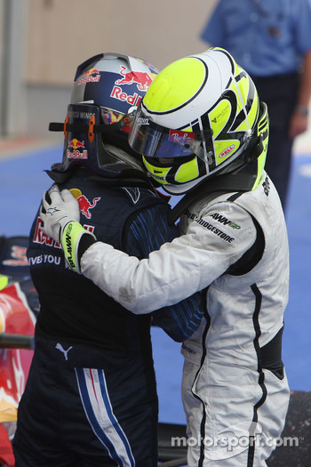 Race winner Jenson Button, Brawn GP celebrates with Sebastian Vettel, Red Bull Racing