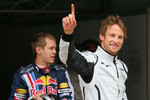 Sebastian Vettel, Red Bull Racing and pole winner Jenson Button, Brawn GP