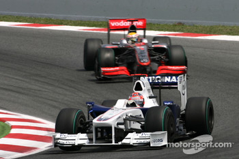 Robert Kubica, BMW Sauber F1 Team and Lewis Hamilton, McLaren Mercedes