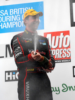 Matt Neal sprays champagne for third
