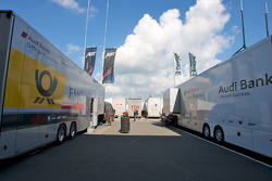 Audi Sport team transporters and paddock area