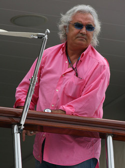 Flavio Briatore, Renault F1 Team, Team Chief, Managing Director waiting on the back of his boat for the FOTA members to arrive
