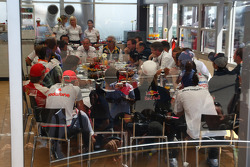 A meeting of Team Principles and drivers is held in the Toyota motorhome